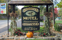 Shamrock Motel and Cottages Long Lake NY Lodging Shamrock sign in autmn